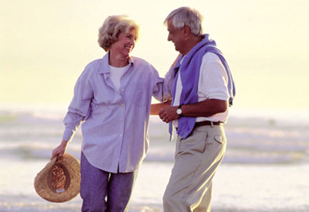senior-couple-on-beach